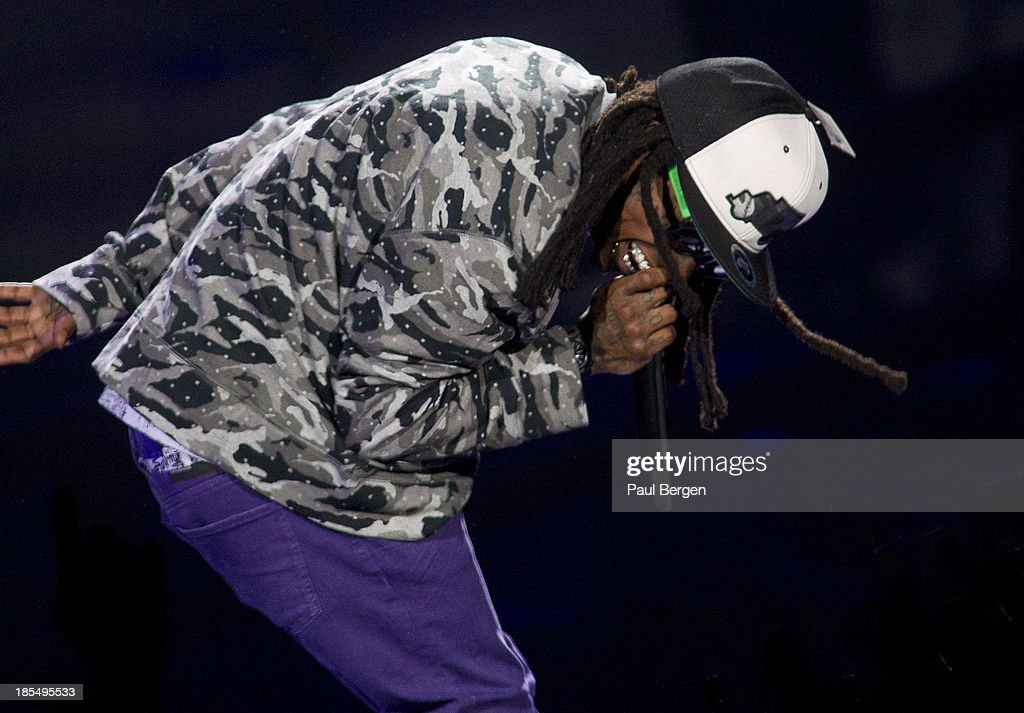 <a gi-track='captionPersonalityLinkClicked' href=/galleries/search?phrase=Lil%27+Wayne&family=editorial&specificpeople=2327970 ng-click='$event.stopPropagation()'>Lil' Wayne</a> performs on stage at Ziggo Dome on October 21, 2013 in Amsterdam, Netherlands.