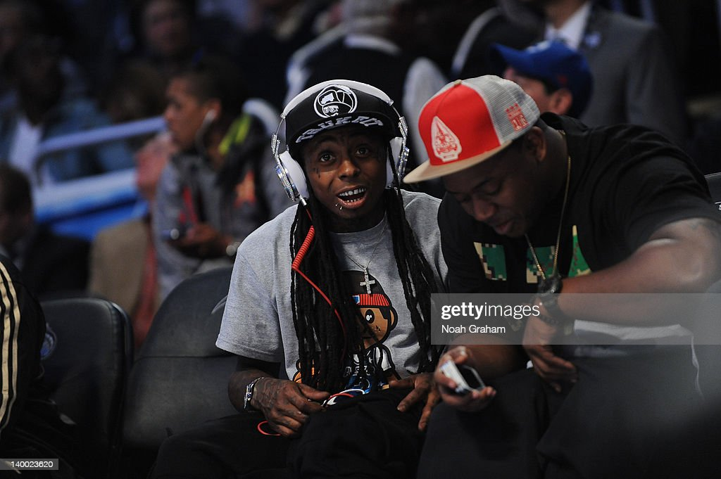 Lil Wayne sits courside during the 2012 NBA All-Star Game presented by Kia Motors as part of 2012 All-Star Weekend at the Amway Center on February 26, 2012 in Orlando, Florida.