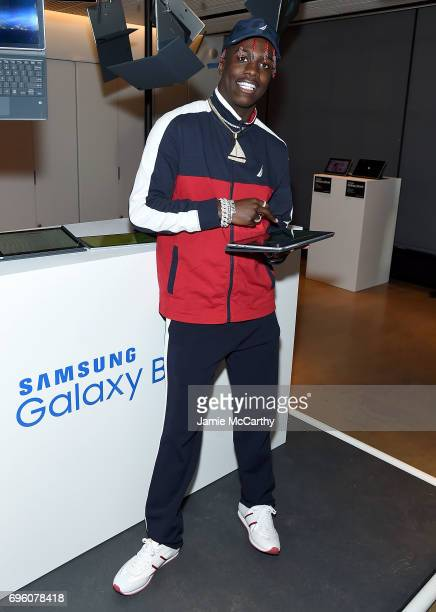 Lil Yachty checks out the new Samsung Galaxy Book during the Samsung Galaxy Book Launch at Samsung 837 on June 14 2017 in New York City