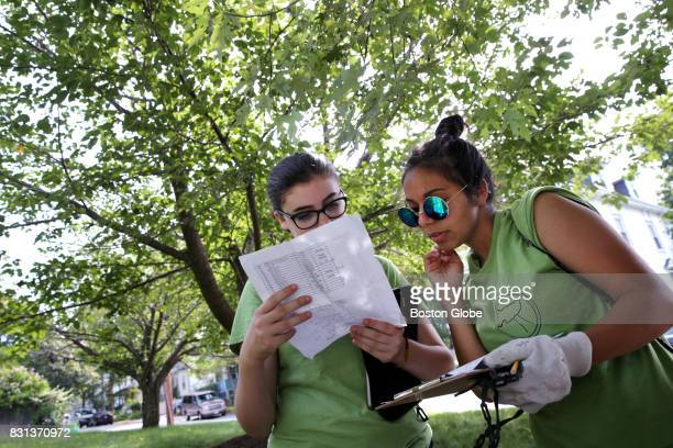 Lila Cherry left and Nezzi Da Silva of the Watertown Teen Tree Stewardship program search for the location of a tree in Watertown MA on Aug 2 2017...