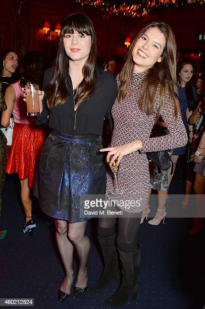 Lilah Parsons and Sarah Ann Macklin attend the Sunday Times Style Xmas Party at Tramp on December 9 2014 in London England