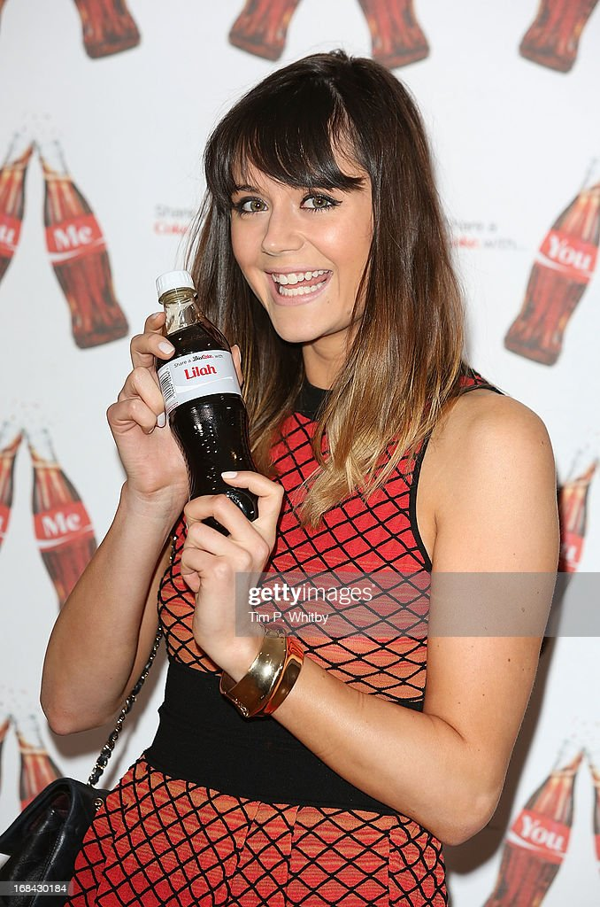 Lilah Parsons with her personalised Diet Coke bottle at the launch of Coca-Cola's, Share a Coke campaign at One Marylebone on May 9, 2013 in London, England.