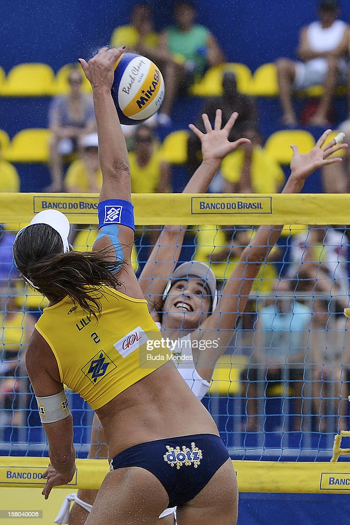 Lili and Carolina in action during a beach volleyball match against the 6th stage of the season 2012/2013 Circuit Bank of Brazil at Copacabana Beach on December 09, 2012 in Rio de Janeiro, Brazil.