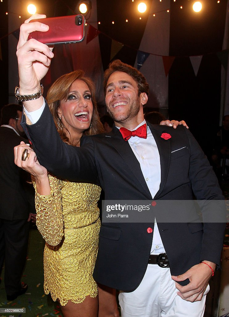 <a gi-track='captionPersonalityLinkClicked' href=/galleries/search?phrase=Lili+Estefan&family=editorial&specificpeople=751373 ng-click='$event.stopPropagation()'>Lili Estefan</a> and Carlos de la Mota attend the Premios Juventud 2014 at The BankUnited Center on July 17, 2014 in Coral Gables, Florida.