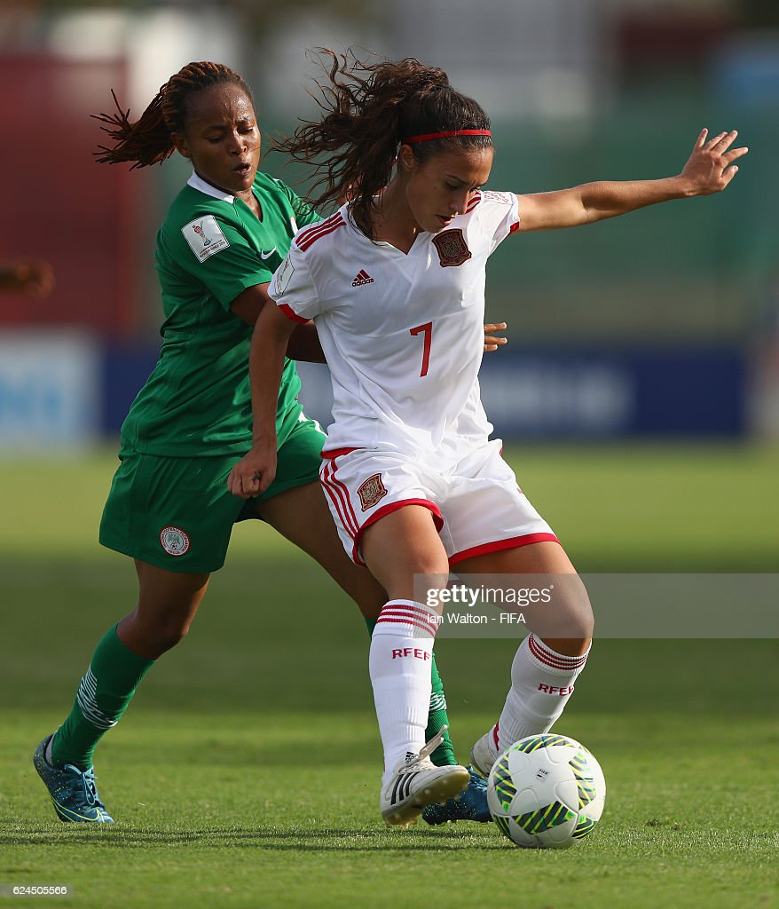 Lilian Mwuese Tule of Nigeria tries to tackle Nahikari Garcia Perez of Spain during the FIFA U-20 Women's World Cup, Group B match between Nigeria and Spain at PNG Football Stadium on November 20, 2016 in Port Moresby, Papua New Guinea.