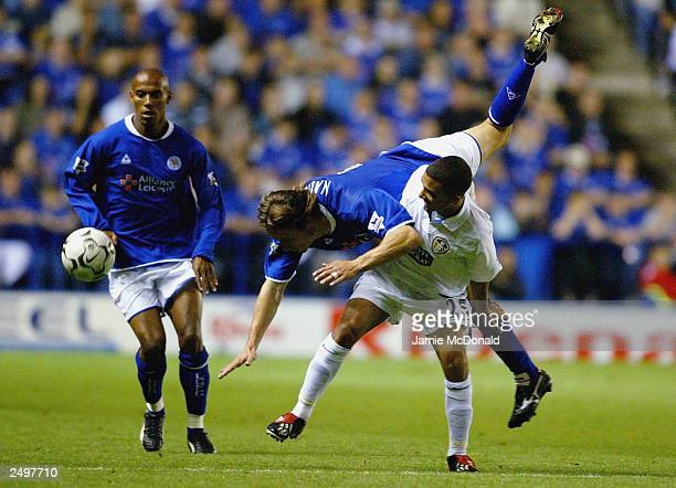 Lilian Nalis of Leicester goes over the top of Aaron Lennon of Leeds during the FA Barclaycard Premiership match between Leicester City and Leeds...