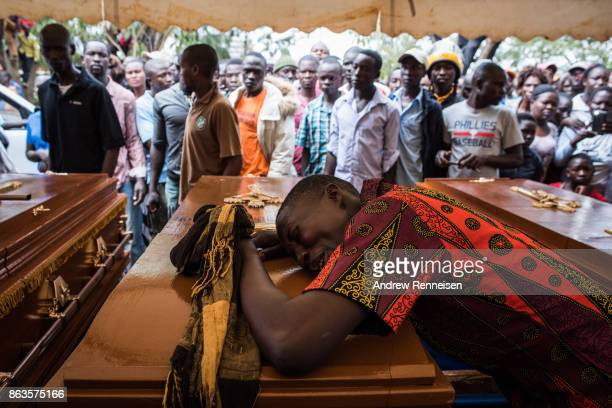 Lilian Ochieng weeps over the casket of her brotherinlaw Stephen Omondi Oduor at a funeral service for three men killed by the police in an...