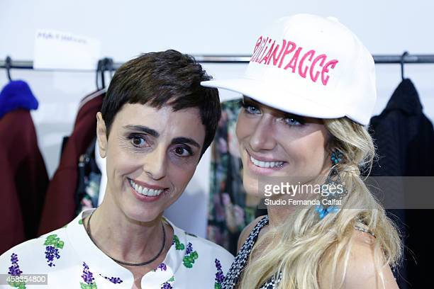 Lilian Pacce and Giovanna Ewbank pose for a photo backstage before the Cavalera fashion show during Sao Paulo Fashion Week Winter 2015 at Parque...