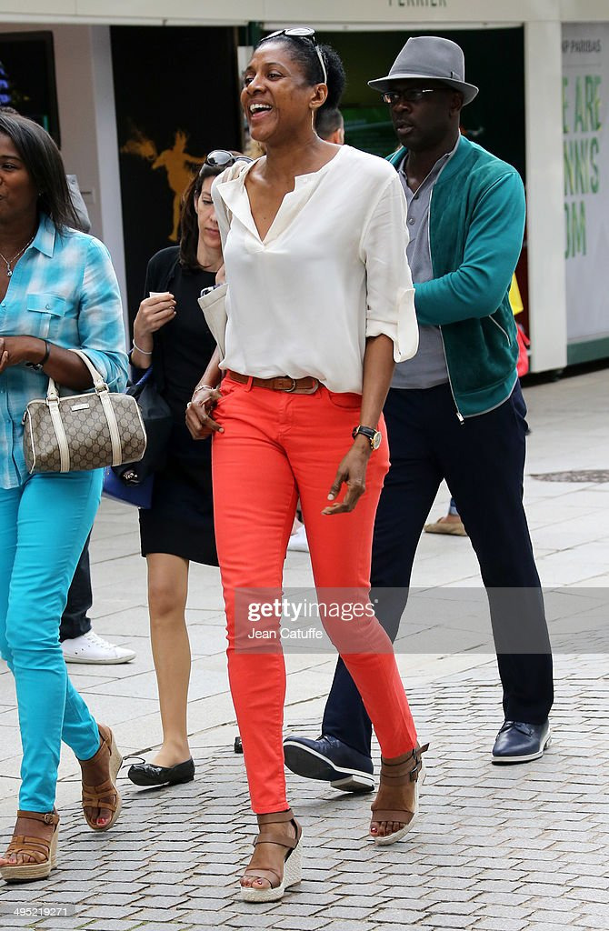 Lilian Thuram and Marie-Jose Perec attend Day 8 of the French Open 2014 held at Roland-Garros stadium on June 1, 2014 in Paris, France.