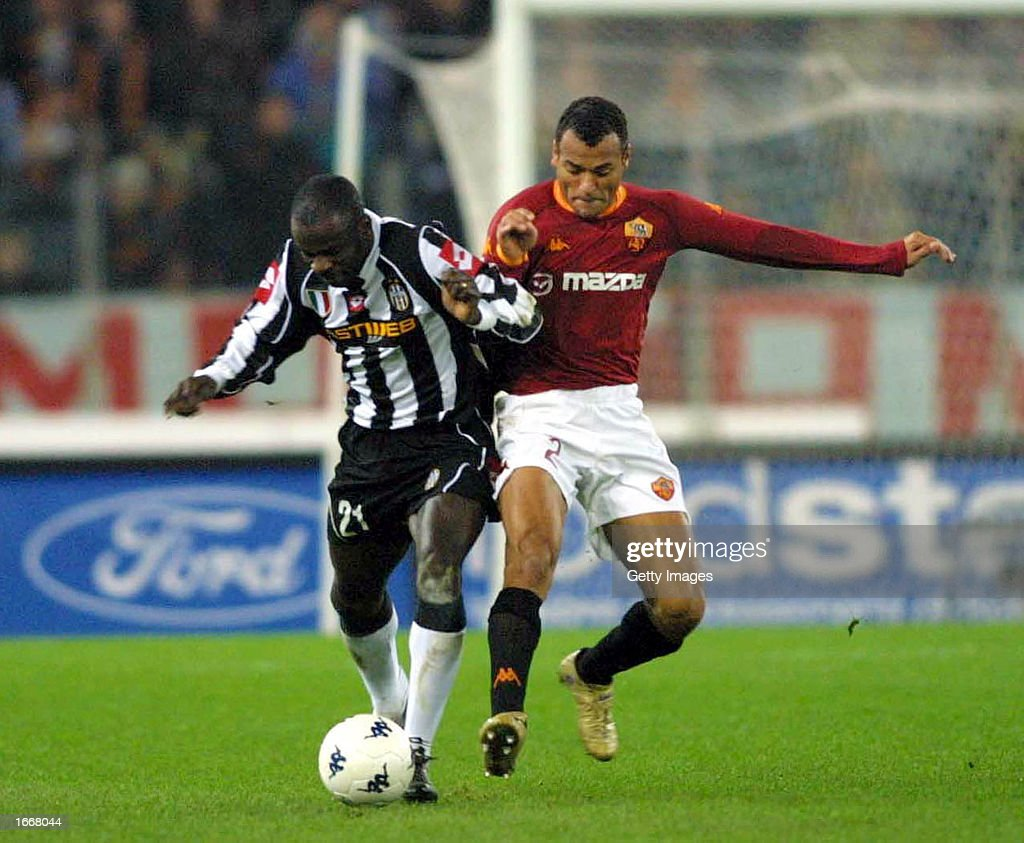 Lilian Thuram of Juventus and Cafu of Roma in action