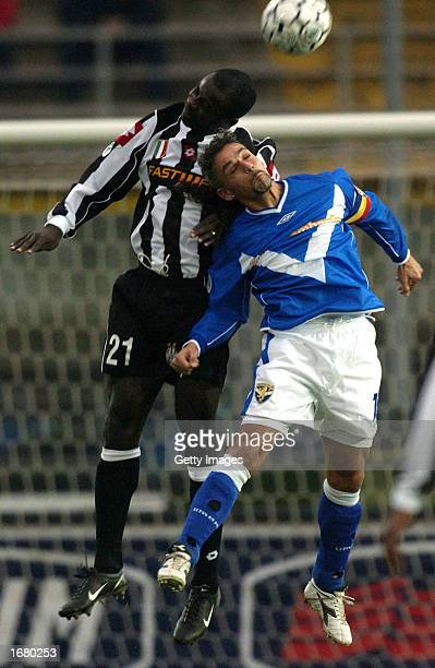Lilian Thuram of Juventus and Roberto Baggio of Brescia in action during the Serie A match between Brescia and Juventus played at the Mario Rigamonti...