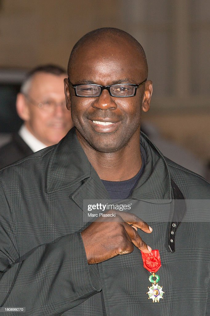 <a gi-track='captionPersonalityLinkClicked' href=/galleries/search?phrase=Lilian+Thuram&family=editorial&specificpeople=211248 ng-click='$event.stopPropagation()'>Lilian Thuram</a> receives the 'officier de la legion d'honneur' medal at Elysee Palace on September 17, 2013 in Paris, France.