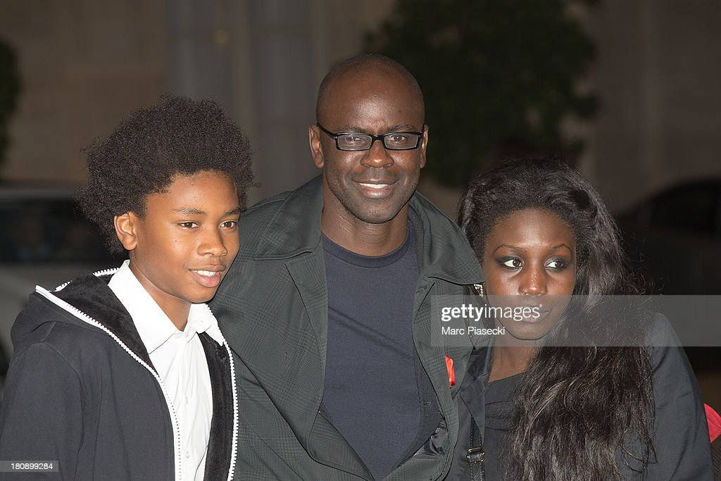 <a gi-track='captionPersonalityLinkClicked' href=/galleries/search?phrase=Lilian+Thuram&family=editorial&specificpeople=211248 ng-click='$event.stopPropagation()'>Lilian Thuram</a> (C) receives the 'officier de la legion d'honneur' medal at Elysee Palace on September 17, 2013 in Paris, France.