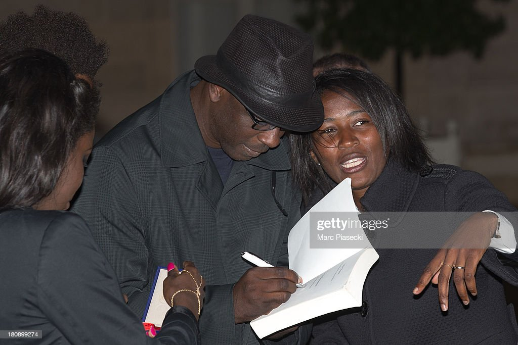 Lilian Thuram (C) signs autographs as he receives the 'officier de la legion d'honneur' medal at Elysee Palace on September 17, 2013 in Paris, France.