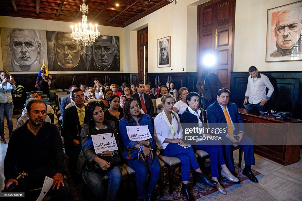Lilian Tintori (3-R) and Antonieta Mendoza (2-R), respectively wife and mother of jailed Venezuelan opposition leader Leopoldo Lopez, attend a meeting with relatives of victims of the 2014 protests in Caracas on February 12, 2016. Between February and May, 2014, 43 people were killed in protests in Venezuela. AFP PHOTO/FEDERICO PARRA / AFP / FEDERICO PARRA