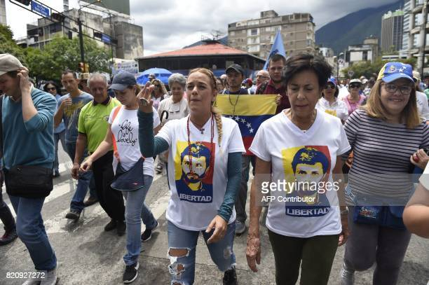 Lilian Tintori and Antonieta Mendoza wife and mother of opposition leader Leopoldo Lopez under house arrest take part in a march towards the Supreme...