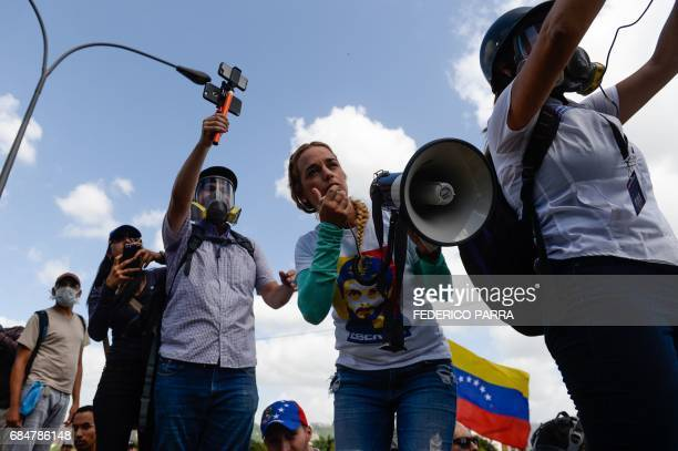 Lilian Tintori wife of imprisoned Venezuelan opposition leader Leopoldo Lopez uses a megaphone during a protest against President Nicolas Maduro in...