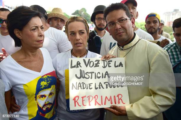 Lilian Tintori wife of jailed opposition leader Leopoldo Lopez and his mother Antonieta Mendoza pose with a placard that reads 'Nobody Can Supress...