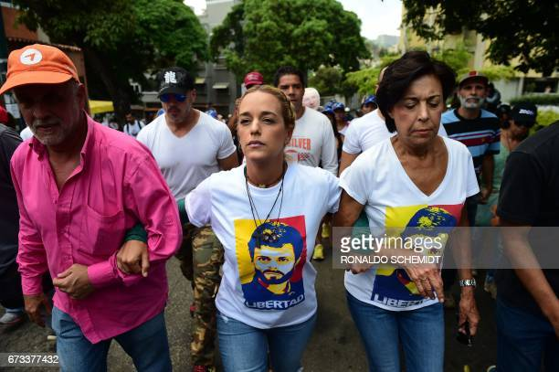 Lilian Tintori wife of jailed opposition leader Leopoldo Lopez and Lopez's mother Antonieta Mendoza de Lopez lead a protest march in Caracas on April...