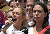Lilian Tintori wife of jailed opposition leader Leopoldo Lopez speaks next to Maria Corina Machado during a demonstration in support of Mayor Antonio...