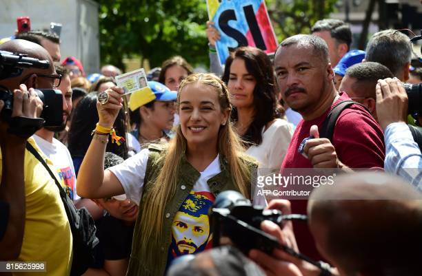 Lilian Tintori wife of the Venezuela's currentlyunderhousearrest opposition leader Leopoldo Lopez shows her ID card at a polling station in Caracas...