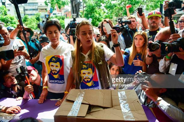 Lilian Tintori wife of the Venezuela's currentlyunderhousearrest opposition leader Leopoldo Lopez casts her vote at a polling station in Caracas on...