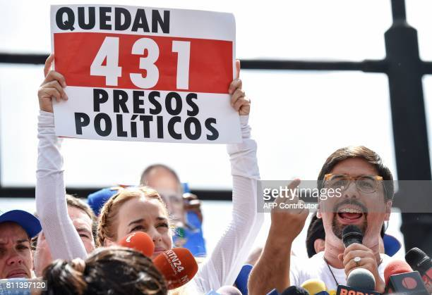 Lilian Tintori wife of Venezuelan political prisoner and opposition leader Leopoldo Lopez holds a placard reading 'There Are Still 431 Political...