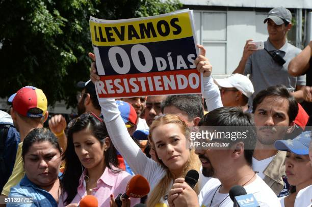 Lilian Tintori wife of Venezuelan political prisoner and opposition leader Leopoldo Lopez holds a placard reading 'We Have Been Resisting For 100...