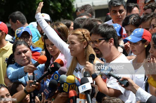 Lilian Tintori wife of Venezuelan political prisoner and opposition leader Leopoldo Lopez waves at the crowd as the vicepresident of the National...