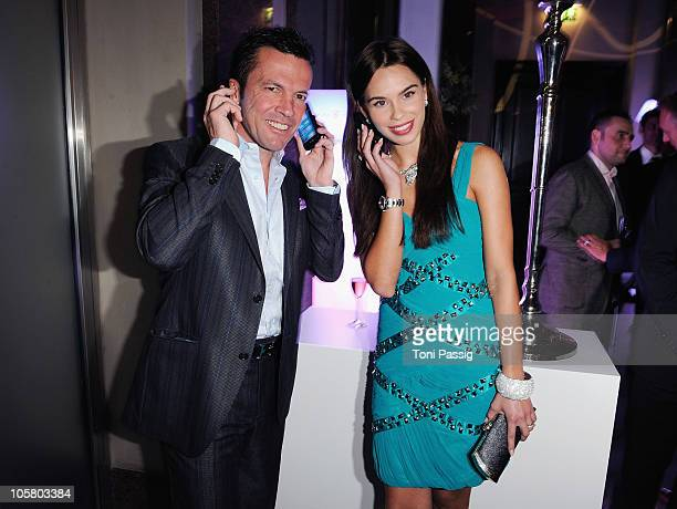 Liliana Matthaeus and Lothar Matthaeus pose with the new Windows Phone during the 'Launch of the new Windows Phone by Deutsche Telekom' at Hotel de...