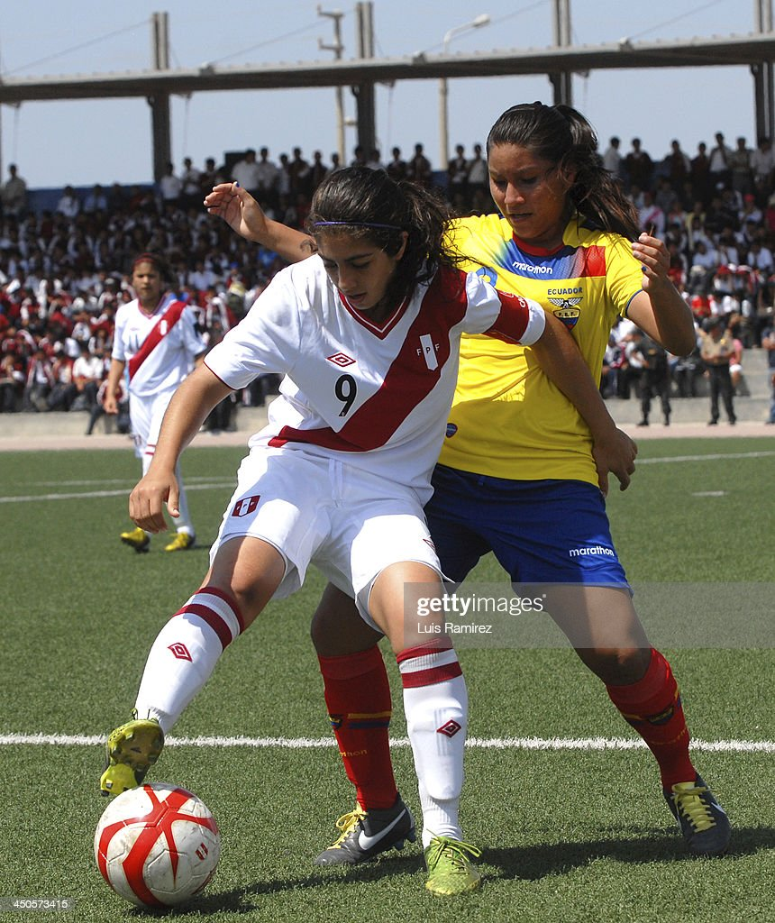Liliana Neyra of Peru fights for the ball with Ariana Cortez of Ecuador during a match between Peru and Ecuador in Women's U-20 football Qualifiers as part of the XVII Bolivarian Games Trujillo 2013 at Colegio San Jose on November 17, 2013 in Chiclayo, Peru.