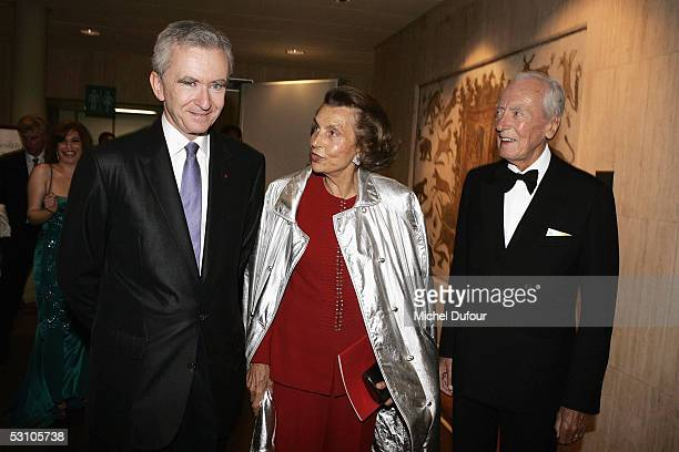 Liliane and Andre Bettencourt and French businessman Bernard Arnault attend 'Le Concert de la Paix' held to raise funds for The Weizmann Institute of...