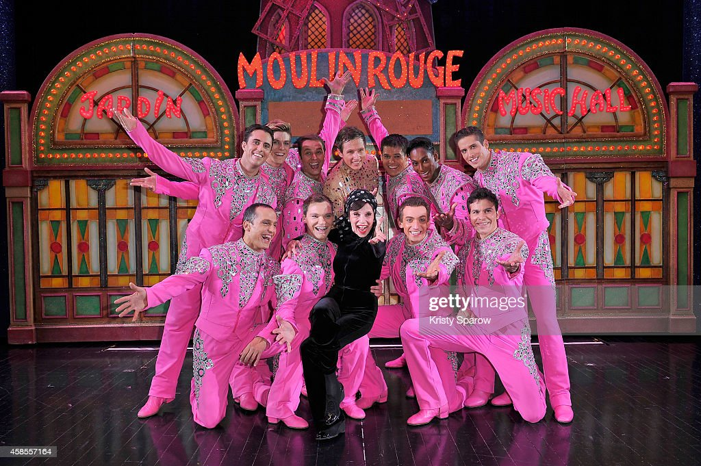 Liliane Montevecchi poses backstage with the Moulin Rouge dancers at the Moulin Rouge on November 6, 2014 in Paris, France.