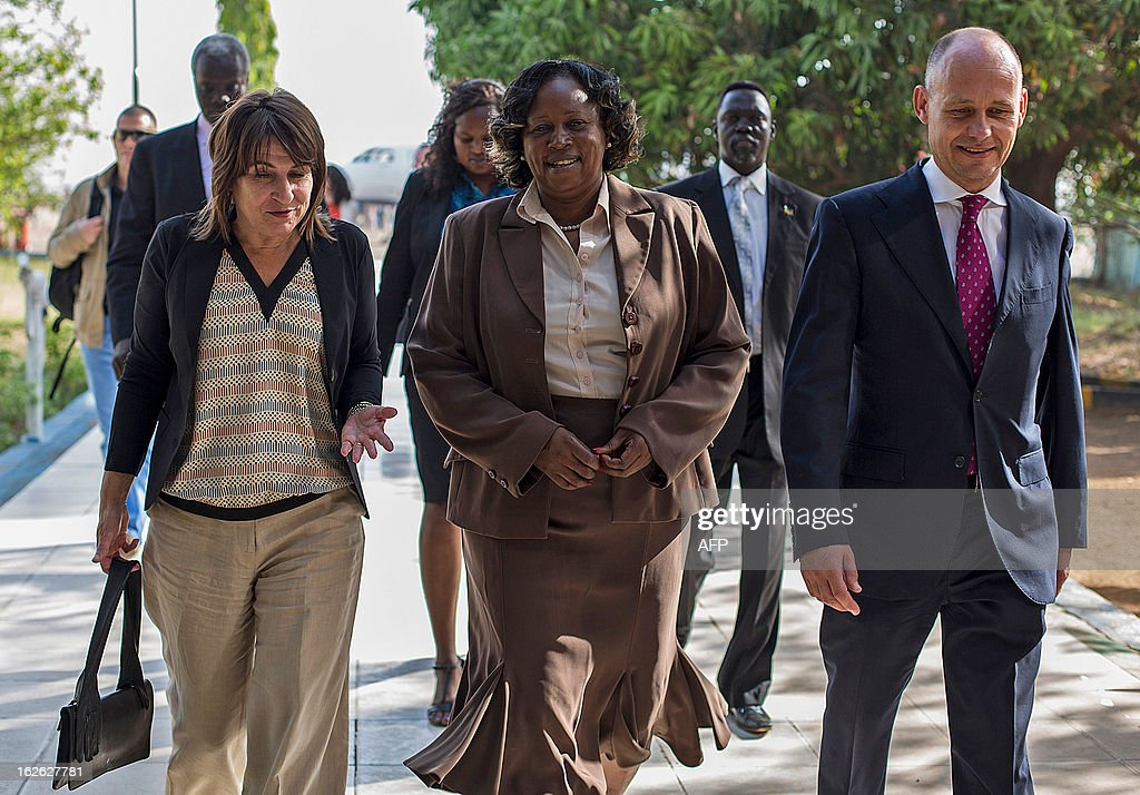 Lilianne Ploumen, the Dutch minister for Foreign Trade and Development Cooperation (L) speaks with South Sudan's vice-minister of Foreign Affairs Grace Daterio (C) and Dutch Embassador to South Sudan Kees van Baar (R) upon her arrival at Juba Airport on February 25, 2013, as part of her four-day official to East Africa. AFP PHOTO/ Camille Lepage
