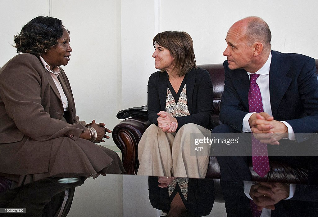 Lilianne Ploumen, the Dutch minister for Foreign Trade and Development Cooperation (C) speaks with South Sudan's vice-minister of Foreign Affairs Grace Daterio (L) eyed by Dutch Embassador to South Sudan Kees van Baar (R) upon her arrival at Juba Airport on February 25, 2013, as part of her four-day official to East Africa. AFP PHOTO/ Camille Lepage