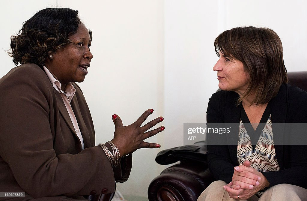 Lilianne Ploumen, the Dutch minister for Foreign Trade and Development Cooperation (R) speaks with South Sudan's vice-minister of Foreign Affairs Grace Daterio in Juba on February 25, 2013, as part of her four-day official visit to East Africa. AFP PHOTO/ Camille Lepage