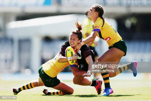 Lilieta Maumau of the Kiwi Ferns is tackled by Ali Brigginshaw and Isabelle Kelly of the Australian Jillaroos during the 2017 Auckland Nines match...