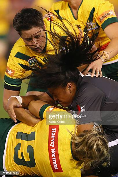 Lilietta Maumau of the Kiwi Ferns is tackled during the Women's international Rugby League Test match between the Australian Jillaroos and New...