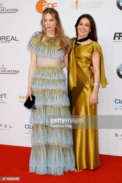 Lilith Stangenberg and Nicolette Krebitz during the Lola German Film Award red carpet arrivals at Messe Berlin on April 28 2017 in Berlin Germany
