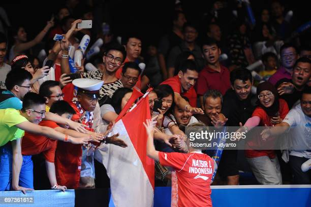 Liliyana Natsir of Indonesia greets the fans after beating Zheng Siwei and Chen Qingchen of China during Mixed Double Final match of the BCA...