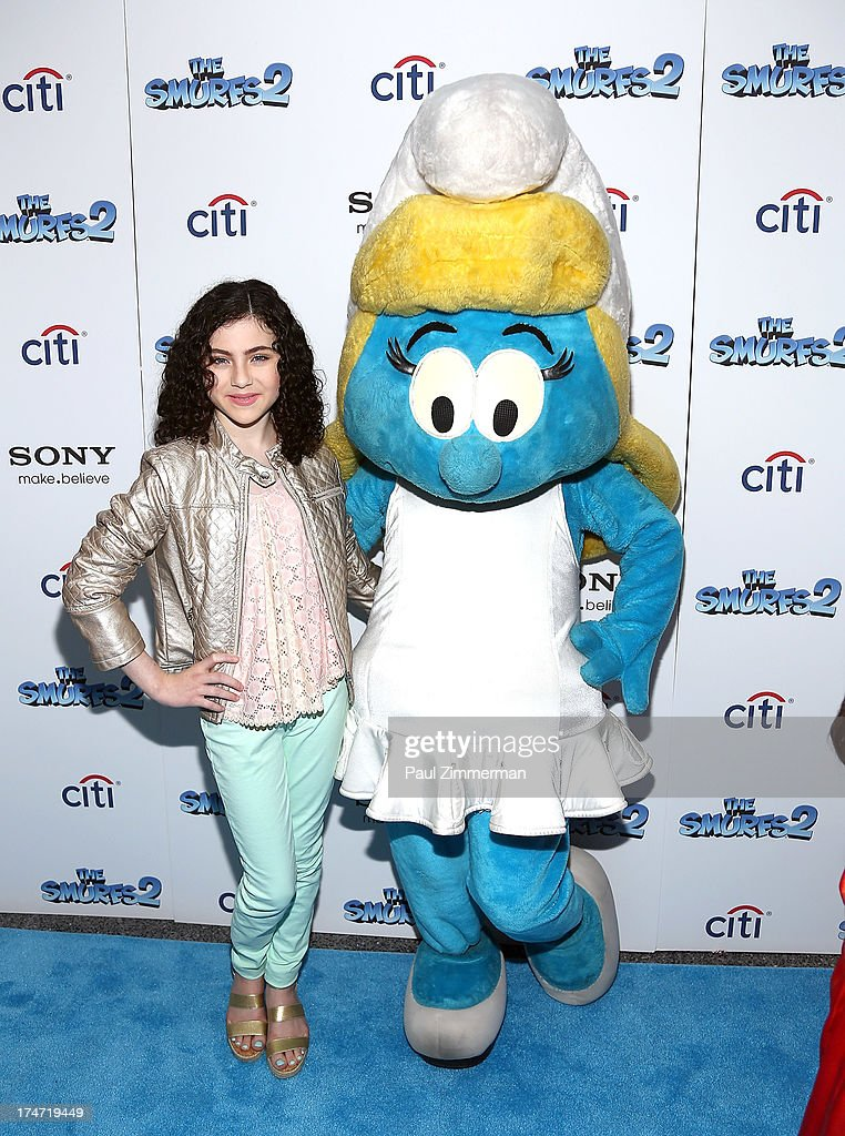 Lilla Crawford and Smurfette attend 'The Smurfs 2' New York Blue Carpet Screening at Lighthouse International Theater on July 28, 2013 in New York City.