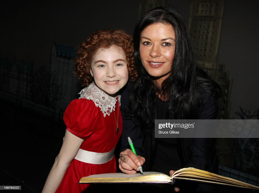 Lilla Crawford as 'Annie' and Catherine Zeta Jones pose backstage at the hit mmusical 'Annie' on Broadway at The Palace Theater on January 20 2013 in...