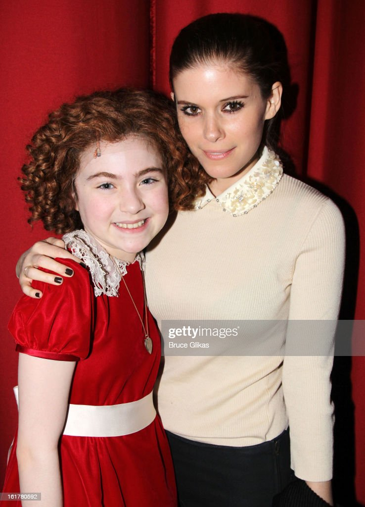 Lilla Crawford as 'Annie' and Kate Mara pose backstage at the hit musical 'Annie' on Broadway at The Palace Theater on February 15 2013 in New York...
