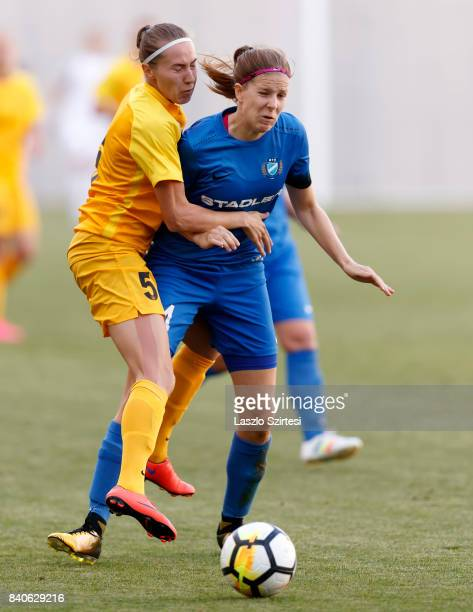 Lilla Turanyi of MTK Hungaria FC tackles Yekaterina Babshuk of WFC BIIKKazygurt during the UEFA Women's Champions League Qualifying match between MTK...