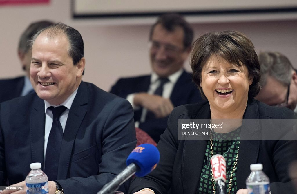 Lille Mayor <a gi-track='captionPersonalityLinkClicked' href=/galleries/search?phrase=Martine+Aubry&family=editorial&specificpeople=590991 ng-click='$event.stopPropagation()'>Martine Aubry</a> (R) smiles beside French Socialist Party's First Secretary Jean Christophe Cambadelis during a press conference on January 23, 2015 in Lille, northern France.