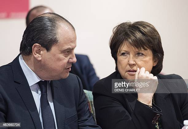 Lille Mayor Martine Aubry speaks with French Socialist Party's First Secretary Jean Christophe Cambadelis during a press conference on January 23...