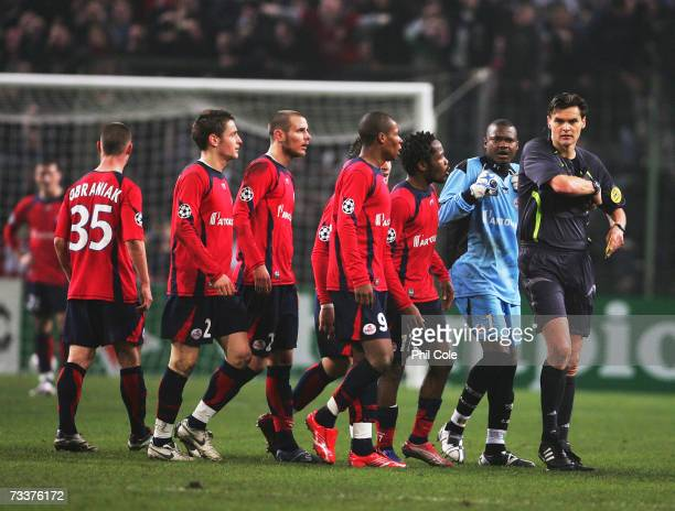 Lille players surround the referee Eric Braamhaar during the Champions League first Knockout round first leg between Lille and Manchester United at...