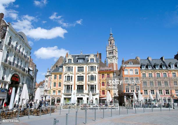 real estate in the heart of the city Flemishstyle buildings in the square 'Grand Place' and belfry of the Chamber of Commerce and Industry