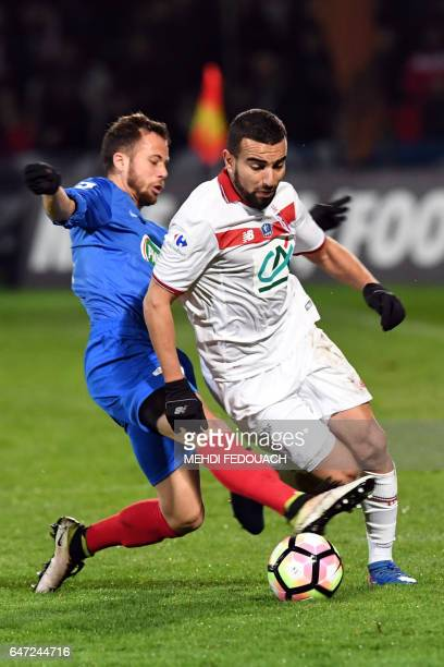 Lille' s French Algerian midfielder Naim Sliti vies with Bergerac's French midfielder Victor Fuchs during the French Cup football match between...