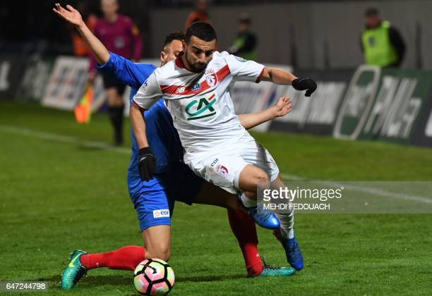Lille' s French Algerian midfielder Naim Sliti vies with Bergerac's French defender Youssef Zidane during the French Cup football match between...